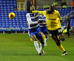 Wigan Athletic's Marc-Antoine Fortune tussles with Reading's Nathaniel Chalobah - Photo mandatory by-line: Paul Knight/JMP - Mobile: 07966 386802 - 17/02/2015 - SPORT - Football - Reading - Madejski Stadium - Reading v Wigan Athletic - Sky Bet Championship