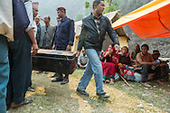Officials arrive with boxes full of cash to distribute the first installment, Rs 50,000 of the promised Rs200,000 homeowners whose properties were damaged or destroyed, at a makeshift facility near the  Singati Bazaar in Dolakha, Nepal  April 13, 2016. Less than one-tenth of a percent, approximately 700 of the 770,000 owners of the affected households, have received cash grants from the government to rebuild their homes.  <br /> Gurkha was one of the hardest hit areas, including the Singati Bazaar, where over 100 bodies were buried under the ruble following the 7.8 magnitude April 25, 2015 earthquake and May 12th aftershock. Singati was the major market for residents of 21 Village Development Committees and many survivors of the April 25th earthquake were in the bazaar buying supplies when the aftershock hit causing a huge landslide.<br /> &copy; 2016 Michelle McLoughlin