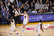 Golden State Warriors guard Klay Thompson (11) celebrates 60 points in three quarters against the Indiana Pacers at Oracle Arena in Oakland, Calif., on December 5, 2016. (Stan Olszewski/Special to S.F. Examiner)