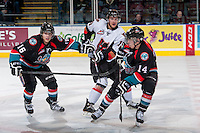 KELOWNA, CANADA - OCTOBER 22: Calder Brooks #19 of the Calgary Hitmen is checked by Kris Schmidli #16 and Rourke Chartier #14 of the Kelowna Rockets on October 22, 2013 at Prospera Place in Kelowna, British Columbia, Canada.   (Photo by Marissa Baecker/Shoot the Breeze)  ***  Local Caption  ***