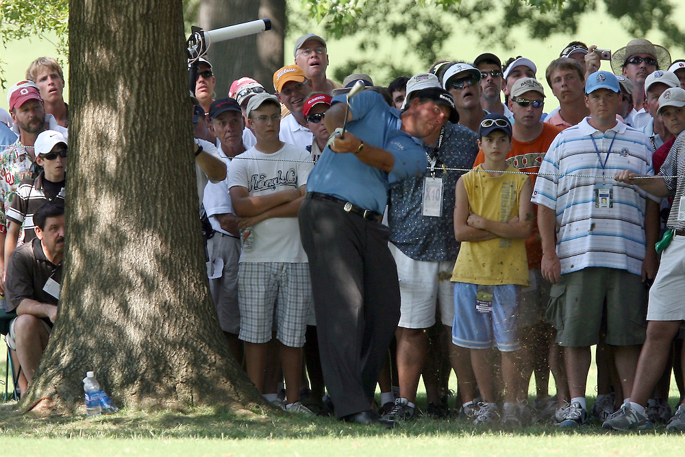09 August 2007: Phil Mickelson hits out of the gallery on the 9th hole during the first round of the 89th PGA Championship at Southern Hills Country Club in Tulsa, OK.