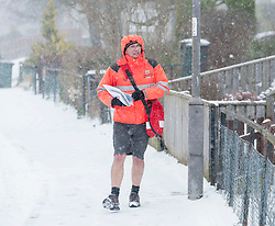 The severe winter weather gripping Scotland had bypassed this postman, spotted on his rounds in Ratho Station just outside Edinburgh, dressed in shorts.<br /> <br /> &copy; Dave Johnston / EEm