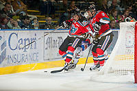 KELOWNA, CANADA - OCTOBER 10: Filip Vakso #10 and Jesse Lees #2 of the Kelowna Rockets block a Spokane player from the puck  as the Spokane Chiefs visit the Kelowna Rockets on October 10, 2012 at Prospera Place in Kelowna, British Columbia, Canada (Photo by Marissa Baecker/Shoot the Breeze) *** Local Caption ***