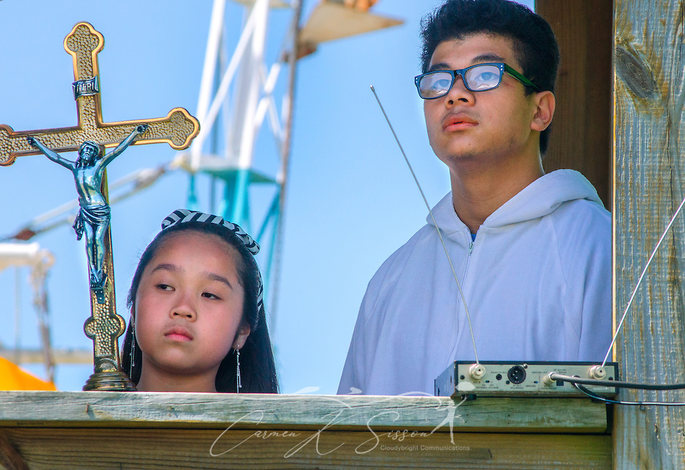 Members of St. Margaret's Catholic Church wait for Catholic Archbishop Thomas J. Rodi to arrive for the 66th annual Blessing of the Fleet in Bayou La Batre, Alabama, May 3, 2015. The first fleet blessing was held by St. Margaret's Catholic Church in 1949, carrying on a long European tradition of asking God's favor for a bountiful seafood harvest and protection from the perils of the sea. The highlight of the event is a blessing of the boats by the local Catholic archbishop and the tossing of a ceremonial wreath in memory of those who have lost their lives at sea. The event also includes a land parade and a parade of decorated boats that slowly cruise through the bayou. (Photo by Carmen K. Sisson/Cloudybright)