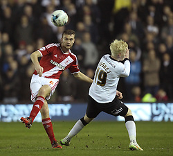 Middlesbrough's Ben Gibson plays a forward pass past Derby County's Will Hughes - Photo mandatory by-line: Robbie Stephenson/JMP - Mobile: 07966 386802 - 17/03/2015 - SPORT - Football - Derby - iPro Stadium - Derby County v Middlesbrough - Sky Bet Championship