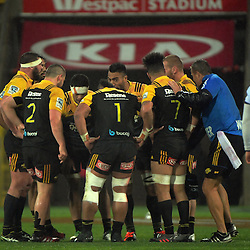 The Hurricanes huddle during the Super Rugby quarterfinal match between the Hurricanes and Sharks at Westpac Stadium, Wellington, New Zealand on Saturday, 23 July 2016. Photo: Dave Lintott / lintottphoto.co.nz
