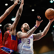 Reno Bighorns Guard MARCUS WILLIAMS (3) shoots a layup against two Agua Caliente Clipper players during the NBA G-League Basketball game between the Reno Bighorns and the Agua Caliente Clippers at the Reno Events Center in Reno, Nevada.