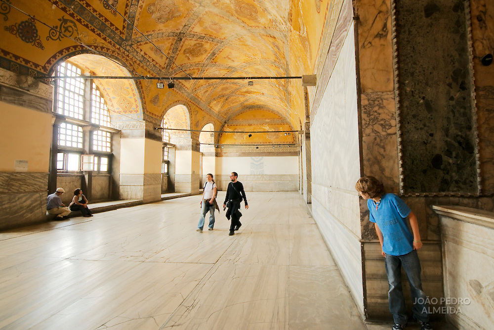 Boy playing hide and seek at Hagia Sofia