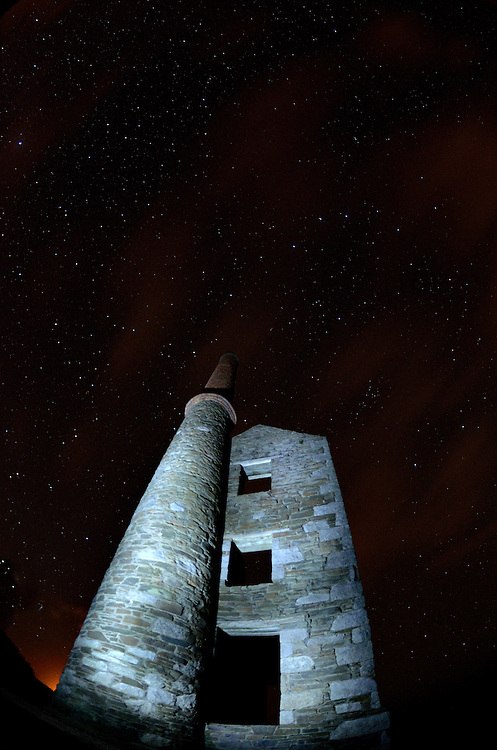 Wheal Prosper in Cornwall at night.<br /> <br /> Despite its name Wheal Prosper was not a hugely succesful mine, working for only six years between 1860-1866. It was intended to mine tin and copper from the Porthcew Lode<br /> <br /> The engine house is dramatically situated on the cliff tops of Rinsey over-looking Rinsey Cove and Porthcew Beach 3 miles from Portleven. Built of granite and killas slate taken from the local clifftops this fine engine house was home to a 30 inch pump.<br /> <br /> There were 3 shafts most notable of which is the now capped Michell's Whim shaft measuring an estimated 420ft in depth.<br /> <br /> The site has been under the stewardship of the National Trust since 1969.