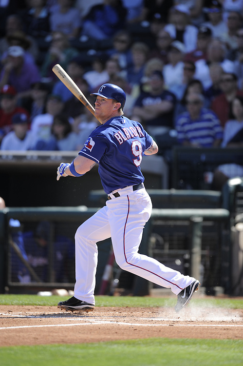 SURPRISE, AZ - MARCH 07:  Hank Blalock #9 of the Texas Rangers bats during the game against the Chicago White Sox on March 7, 2009 at Surprise Stadium in Surprise, Arizona. (Photo by Ron Vesely)