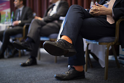 © Licensed to London News Pictures . 16/02/2017. Stoke-on-Trent, UK. GARETH SNELL's socks at a hustings in Stoke-on-Trent Central by-election for local businesses with Lib Dem candidate Dr Zulfiqar Ali, Conservative candidate Jack Brereton,  Labour candidate Gareth Snell and, in place of UKIP candidate Paul Nuttall who didn't turn up , Patrick O'Flynn . Photo credit: Joel Goodman/LNP