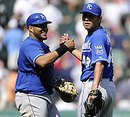 CHICAGO - JULY 06:  Bryan Pena #27 celebrates with Joakim Soria #48 of the Kansas City Royals after the game against the Chicago White Sox on July 6, 2011 at U.S. Cellular Field in Chicago, Illinois.  The Royals defeated the White Sox 4-1.  (Photo by Ron Vesely/MLB Photos via Getty Images)  *** Local Caption *** Bryan Pena;Joakim Soria