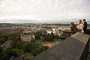 People looking down at Old Town from Edinburgh Castle. Edinburgh, Scotland, UK