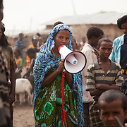 It is Tuesday and market day in Delafagi. People travel from far to sell their goods, to stock-up and to socialise. Hasna is 19 years old and part time health worker trained by AISDA. She spends the morning in the market to advocate stopping the FGM practise, a practice she as a young woman only knows too well the consequences of. She uses a megaphone and she does not mince her words, when she proclaims that 'salot', the Afar word for mutilation of the female genitals is bad and a wrong practice and must be stopped.  Action for Integrated Sustainable Development Association (AISDA) work in the AFAR region of Eastern Ethiopia, based in Delafagi. The Afars practise an old tradition of Female Genital Mutilation where the baby girls has her clitoris and labia cut away and her vagina sewn up. The day before her wedding day the girl is un-stiched ready for marriage. Its a brutal and barbaric tradition which AISDA is challenging with great effect, now more than a hundred girls in Dowe district have been saved from the knife and AISDA is now rolling out the scheme in Delafagi. Delafagi is where the oldest ever human remains have been found, the found is thought to be 4.5 mill years old.megaphone and she does not mince her words, when she proclaims that 'salot', the Afar word for mutilation of the female genitals is bad and a wrong practice and must be stopped.  Action for Integrated Sustainable Development Association (AISDA) work in the AFAR region of Eastern Ethiopia, based in Delafagi. The Afars practise an old tradition of Female Genital Mutilation where the baby girls has her clitoris and labia cut away and her vagina sewn up. The day before her wedding day the girl is un-stiched ready for marriage. Its a brutal and barbaric tradition which AISDA is challenging with great effect, now more than a hundred girls in Dowe district have been saved from the knife and AISDA is now rolling out the scheme in Delafagi. Delafagi is where the oldest ever human remains have been fou