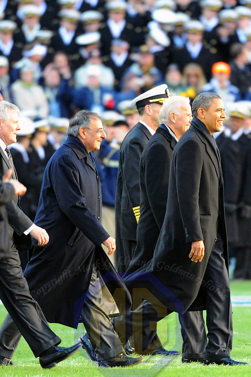 10 December 2011:   President Barack Obama, Vice President Joe Biden and Secretary of Defense Leon Panetta walk across the field at the start of the 112th annual Army Navy game at Fed Ex field in Landover, Md. where Navy defeated Army, 27-21 for the 10th consecutive time.