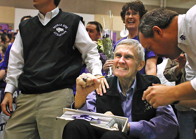 Coach Gary Alverson reacts Wednesday night to the unveiling of the 2005 state basketball championship banner and the retirement of the basketball jersey he wore in 1963-64. His wife Lois smiles at the tribute paid to her husband whose health has been declining due to a battle with cancer. He passed away 5 days later.