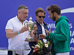 LIVERPOOL, ENGLAND - Sunday, June 23, 2019: Paulo Lorenzi (ITA) is presented with the Boodle & Dunthorne trophy by xxxx of xxxx after the Men's Final on Day Four of the Liverpool International Tennis Tournament 2019 at the Liverpool Cricket Club. (Pic by David Rawcliffe/Propaganda)