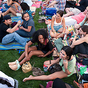 July 13, 2013 - New York, NY : People crowd the Great Lawn in Central Park on Saturday evening in anticipation of the New York Philharmonic's performance in the free MLB All-Star Charity Concert to benefit Hurricane Sandy victims on July 13, 2013.  Pop star Mariah Carey (not pictured) made a guest appearance. <br /> CREDIT: Karsten Moran for The New York Times