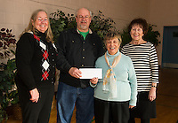 "Tony Felch presents a check on behalf of NH-1 Children's Auction in the amount of $1500.00 to Hands Across The Table volunteers Debbie Frawley Drake, Irene Gordon and Dotty Faulkner during the ""Soupathon"" Sunday evening.  (Karen Bobotas/for the Laconia Daily Sun)"