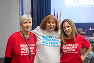 Hempstead New York, October 5, 2018. Members of Nassau and Suffolk County MOMS DEMAND ACTION for Gun Sense in America, wearing red white and blue shirts, pose before start of Sen. Gillibrand's Town Hall Meeting at Hofstra University on Long Island.