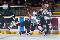 KELOWNA, CANADA - DECEMBER 30: Nick Merkley #10 of Kelowna Rockets avoids a check by a player of the Prince George Cougars on December 30, 2014 at Prospera Place in Kelowna, British Columbia, Canada.  (Photo by Marissa Baecker/Shoot the Breeze)  *** Local Caption *** Nick Merkley;