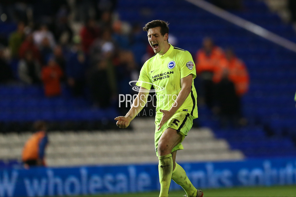 Match winner and 2nd goal scorer Brighton central defender, Lewis Dunk (5)  celebrates the victory during the Sky Bet Championship match between Birmingham City and Brighton and Hove Albion at St Andrews, Birmingham, England on 5 April 2016. Photo by Simon Davies.