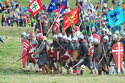 © Licensed to London News Pictures. 13/10/2018<br /> BATTLE, UK.<br /> Norman army on the attack at the battle.<br /> English Heritage Battle of Hastings re-enactment at Battle Abbey,Battle, on the 1066 battle field.<br /> Photo credit: Grant Falvey/LNP