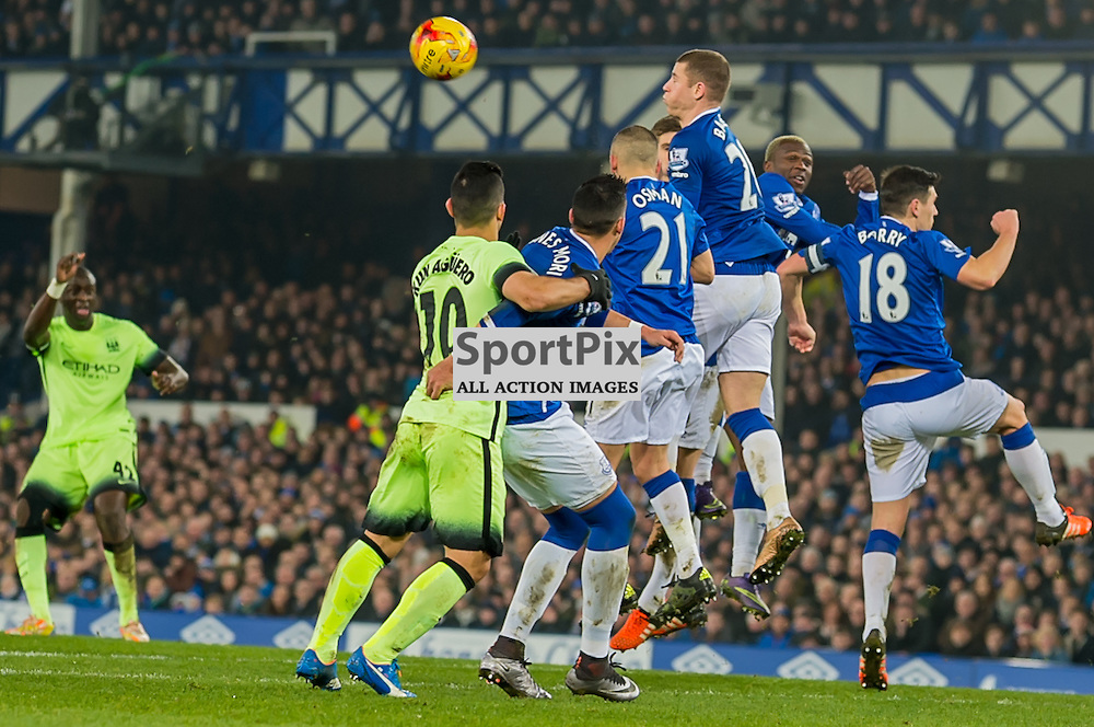 the Everton wall defend a free kick from Manchester City midfielder Yaya Toure in the Football League cup semi-final first leg at Goodison Park, Liverpool