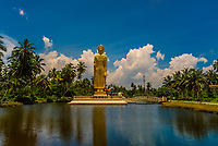 A 30 m tall (54 ft) statue of Buddha facing the ocean at Tsunami Honganji Vihara commemorates more than 2,000 victims who perished in the 2004 tsunami. Hikkaduwa, south coast of Sri Lanka. The Buddha facing the waves with his hands in the abhaya mudra (Buddha pose conveying fearlessness and protection). The statue is a replica of Afghanistan's Bamiyan Buddha, which was destroyed by the Taliban in 2001.