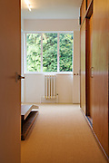 A dressing room and closets at Warren House, Wayne McGregor's Dartington Estate home in Devon<br /> Vanessa Berberian for The Wall Street Journal