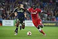 Kenwyne Jones of Cardiff city &reg; holds off Middlesbrough's Kenneth Omeruo. Skybet football league championship match, Cardiff city v Middlesbrough at the Cardiff city stadium in Cardiff, South Wales on Tuesday 16th Sept 2014<br /> pic by Andrew Orchard, Andrew Orchard sports photography.