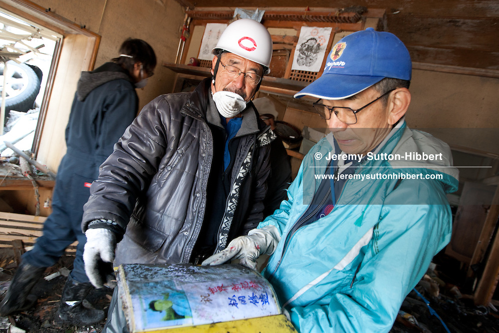 Friends and colleagues of the 104year old Takashi Shimokawara, who died in the March 11th tsunami, begin to clear the debris of the tsunami from his home in Kamaishi city, Tohoku region, Japan, on Tuesday 12th April 2011. Shimokawara-san lost his life in the tsunami, along with his son and daughter-in-law. Takashi Shimokawara was known for the world records he held in javelin throwing in the over 100 year olds category of the sport.