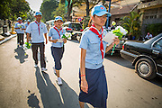 "04 FEBRUARY 2013 - PHNOM PENH, CAMBODIA: Cambodian Boy and Girl Scouts walk to the National Museum for the cremation of King-Father Norodom Sihanouk to begin. Norodom Sihanouk (31 October 1922 - 15 October 2012) was the King of Cambodia from 1941 to 1955 and again from 1993 to 2004. He was the effective ruler of Cambodia from 1953 to 1970. After his second abdication in 2004, he was given the honorific of ""The King-Father of Cambodia."" Sihanouk died in Beijing, China, where he was receiving medical care, on Oct. 15, 2012.    PHOTO BY JACK KURTZ"