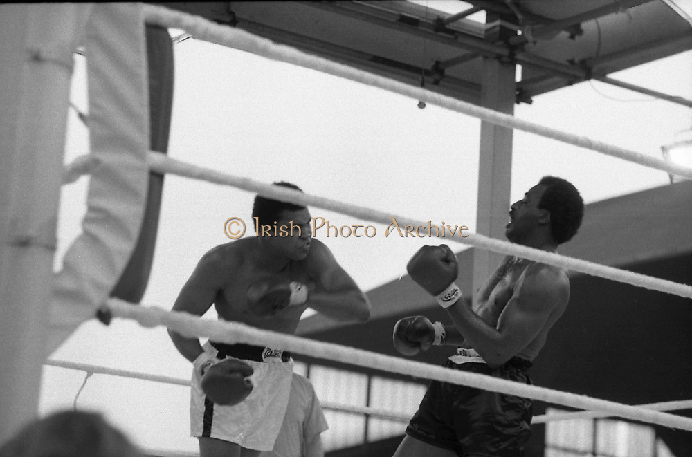 Ali vs Lewis Fight, Croke Park,Dublin.<br /> 1972.<br /> 19.07.1972.<br /> 07.19.1972.<br /> 19th July 1972.<br /> As part of his built up for a World Championship attempt against the current champion, 'Smokin' Joe Frazier,Muhammad Ali fought Al 'Blue' Lewis at Croke Park,Dublin,Ireland.  Muhammad Ali won the fight with a TKO when the fight was stopped in the eleventh round.<br /> <br /> Image of Ali as he rocks Lewis with a left cross.