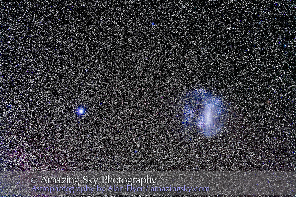 The Large Magellanic Cloud and Canopus, shot from Coonabarabran, Australia, December 13, 2012, with a 50mm Sigma lens at f/3.2 and Canon 5D MkII at ISO 800 for a stack of 4 x 4 minute exposures. Some light haze added natural glows around the stars.