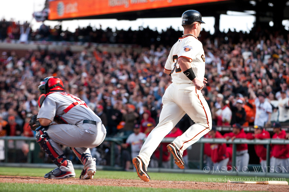 April 8, 2011; San Francisco, CA, USA;  San Francisco Giants center fielder Aaron Rowand (33) scores the game tying run against the St. Louis Cardinals during the ninth inning at AT&T Park.