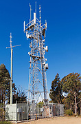 Antennas, lattice tower and base station shelter 3 sector cellular  communications  mobile telephone system in New South Wales, Australia.
