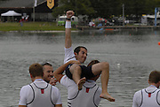 Munich, GERMANY, 02.09.2007,   A Final, USA M4+ cox Edmund DEL GUERCIO is carried to the water edge ,  at  the 2007 World Rowing Championships, taking place on the  Munich Olympic Regatta Course, Bavaria. [Mandatory Credit. Peter Spurrier/Intersport Images]. , Rowing Course, Olympic Regatta Rowing Course, Munich, GERMANY