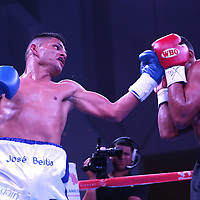 Jose Beitia punches Eliecer Tenoria during their WBO boxing match at the Hotel El Panama Convention Center on Wednesday, October 31, 2018 in Panama City, Panama. (Alex Menendez via AP)