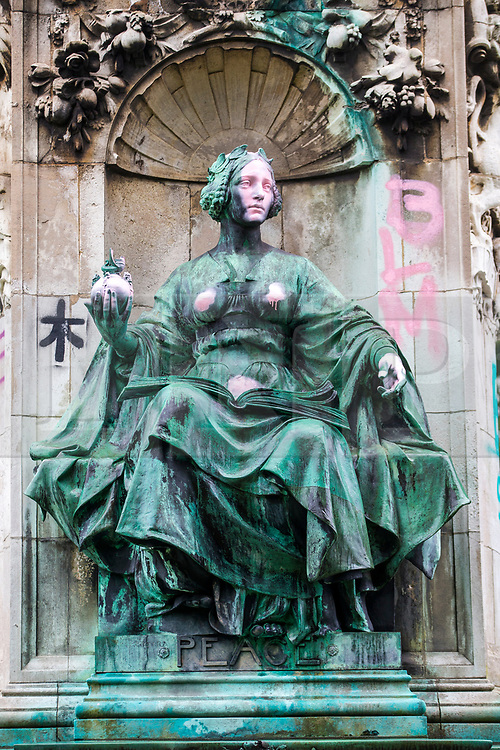 """© Licensed to London News Pictures. 10/06/2020. Leeds UK.  A statue of Queen Victoria at Hyde Park in Leeds has been sprayed with graffiti including the words """"murderer"""" and """"slave owner"""". The bronze sculpture on Woodhouse Moor in the Hyde Park area of the city also had the words """"coloniser"""" and """"racist"""" daubed on it.<br /> Several statues have been targeted after a statue of 17th Century slave trader Edward Colston was torn off its plinth in Bristol by protesters. Photo credit: Andrew McCaren/LNP"""