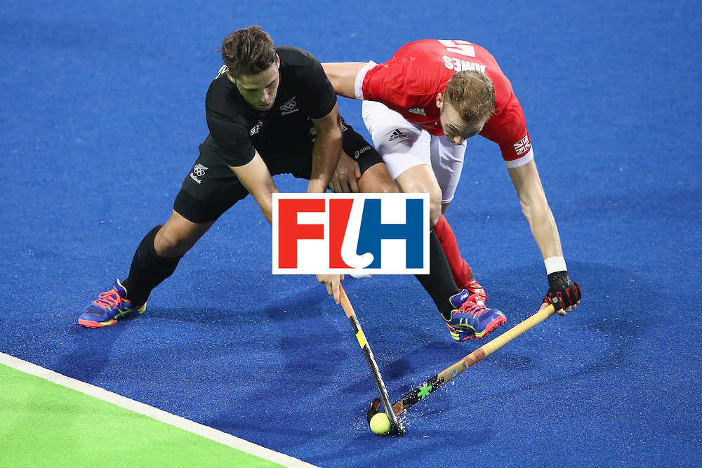 RIO DE JANEIRO, BRAZIL - AUGUST 07:  Nick Wilson of New Zealand and David Ames of Great Britain compete for the ball  during the men's pool A match between Great Britain and New Zealand on Day 2 of the Rio 2016 Olympic Games at the Olympic Hockey Centre on August 7, 2016 in Rio de Janeiro, Brazil.  (Photo by Mark Kolbe/Getty Images)