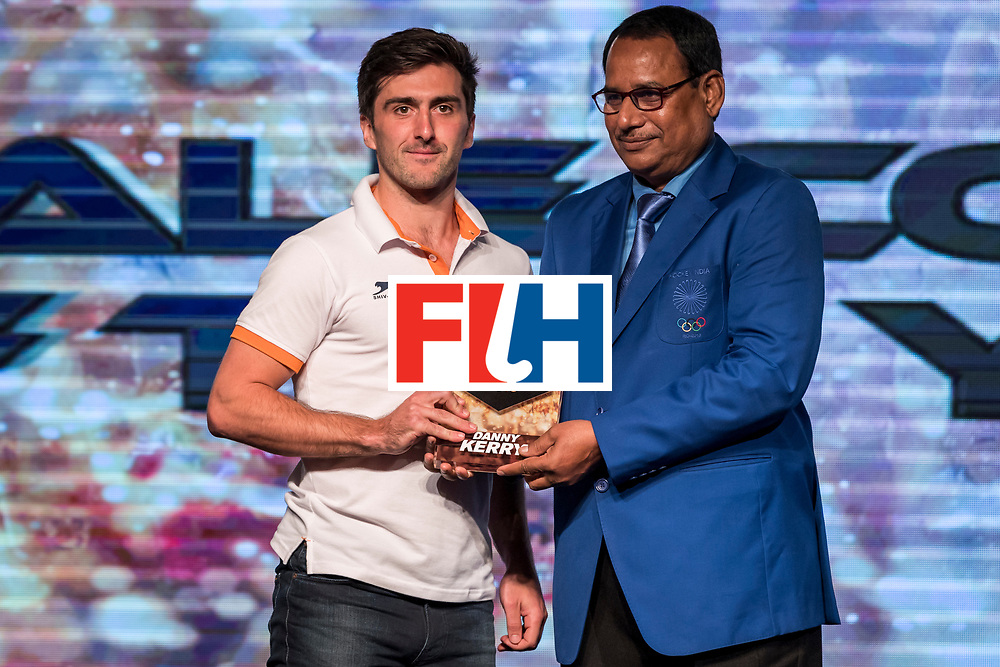 CHANDIGARH, INDIA - FEBRUARY 23: Winner of the FIH Male Coach of the Year Danny Kerry of England award received by Adam Dixon [L] presented by Mohd. Mushtaque Ahmad [R], General Secretary of Hockey India during the FIH Hockey Stars Awards 2016 at Lalit Hotel on February 23, 2017 in Chandigarh, India. (Photo by Ali Bharmal/Getty Images for FIH)