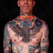Portrait with his tattoo that cover his whole body, photographed at Folsom Street East S&amp;M Street Fair.<br /> <br /> Body art or tattoos has entered the mainstream it is known longer considered a weird kind of subculture.<br /> <br /> &quot;According to a 2006 Pew survey, 40% of Americans between the ages of 26 and 40 have been tattooed&quot;.