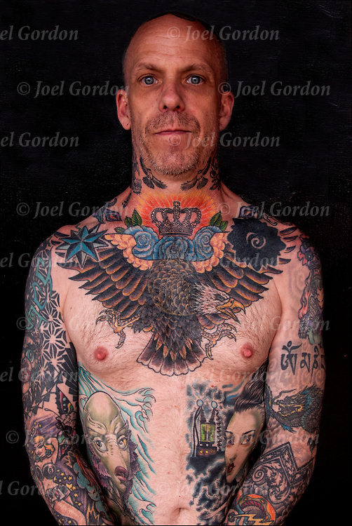 Portrait with his tattoo that cover his whole body, photographed at Folsom Street East S&amp;M Street Fair.<br />