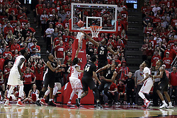 20 March 2017:  Tony Wills(12) hooks a lefty layup around Chad Brown during a College NIT (National Invitational Tournament) 2nd round mens basketball game between the UCF (University of Central Florida) Knights and Illinois State Redbirds in  Redbird Arena, Normal IL