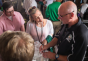 Shannon McGregor, center, a student in the MAA program gets some campus directions from faculty member and program director Scott Smith during the opening reception in the Ohio University Inn on Thursday, June 25, 2015. © Ohio University / Photo by Rob Hardin