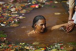 May 4, 2019 - Kathmandu, Nepal - A devotee takes a holy bath in memory of deceased mothers on Mother's Day at Mata Tirtha pond, a pilgrimage site in Kathmandu, Nepal on Saturday, May 04, 2019. It is believed that those who take a holy bath in remembrance of deceased mothers in Mata Tirtha helps his/her mother reach salvation and bring prosperity to the family. (Credit Image: © Skanda Gautam/ZUMA Wire)