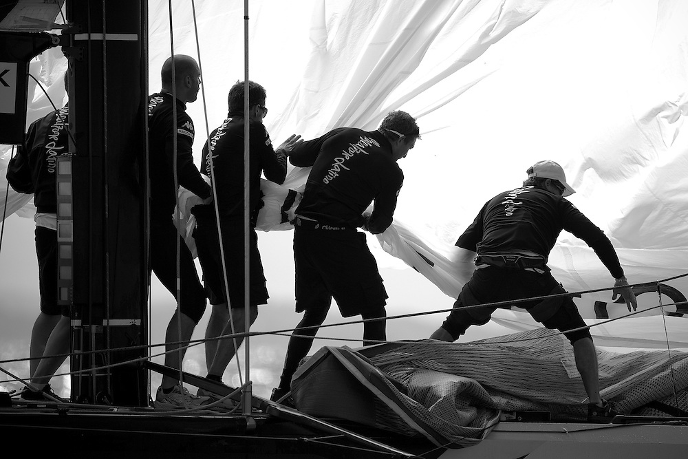 Spinnaker drop on Mascalzone Latino. Louis Vuitton Trophy, Auckland, New Zealand. 14 March 2010. Photo: Gareth Cooke/Mascalzone Latino Audi Team
