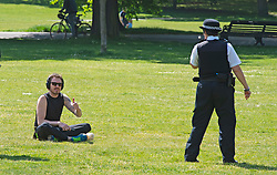 ©Licensed to London News Pictures 06/05/2020  <br /> Greenwich, UK. Police on patrol asking this man to move on. People out and about in Greenwich park, Greenwich, London exercising and enjoying the warm sunny weather.  Photo credit:Grant Falvey/LNP