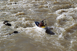 man in a canoe riding The Rio Chama in New Mexico